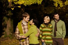Happy couples in autumn forest Royalty Free Stock Image
