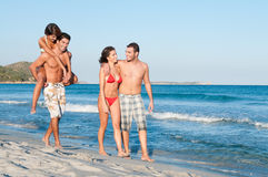 Happy couples at beach Royalty Free Stock Images