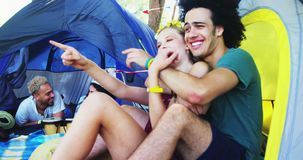 Couples enjoying and relaxing in tent 4k. Happy couples enjoying and relaxing in tent 4k stock video
