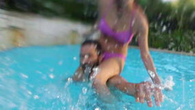 Happy couples having fun. In swimming pool stock footage