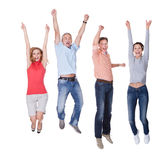 Happy couples jumping in the air rejoicing Stock Photo