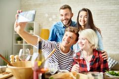 Happy Couples Posing for Selfie stock images