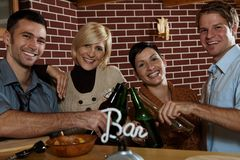 Happy couples in pub Stock Images