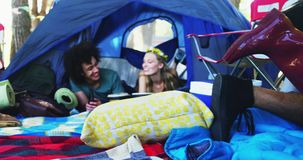 Couples relaxing on tent at music festival 4k. Happy couples relaxing on tent at music festival 4k stock footage