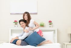 Happy couples smile and sitting on bed, royalty free stock photo