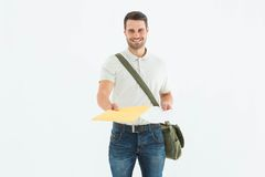 Happy courier man giving envelops Stock Image