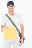 Happy courier man giving envelops Stock Photography