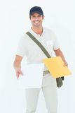 Happy courier man giving parcel Royalty Free Stock Images