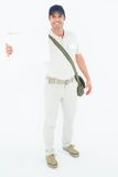 Happy courier man showing envelops Royalty Free Stock Photography