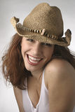 Happy Cowgirl. Womane Laughing in her Cowboy Hat royalty free stock image