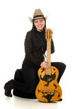 Happy cowgirl in ahat with acoustic guitar Royalty Free Stock Photography