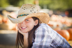 Happy Cowgirl in a Hat at the Pumpkin Patch Royalty Free Stock Image