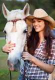 Happy cowgirl with her white horse Stock Images