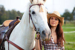 Happy cowgirl taking her horse out Royalty Free Stock Photography