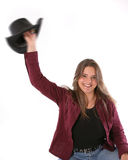 Happy cowgirl waving hat Royalty Free Stock Images