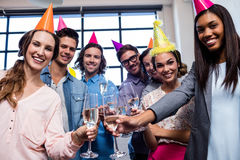 Happy coworker drinking champagne to celebrate a birthday Stock Image