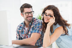 Happy coworkers with glasses posing Royalty Free Stock Image