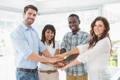 Happy coworkers joining hands in a circle Stock Photography