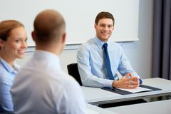 Happy coworkers meeting and talking at office Royalty Free Stock Image