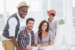 Happy coworkers posing and looking at camera Royalty Free Stock Photos