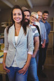 Happy coworkers standing in row at creative office Royalty Free Stock Photography