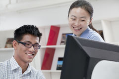 Happy coworkers working on their computer in the office Stock Photography