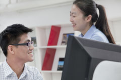 Happy coworkers working on their computer in the office Royalty Free Stock Photography