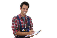 Happy craftsmen taking notes Royalty Free Stock Image
