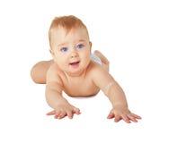 Happy crawling baby boy Stock Image
