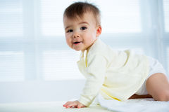 Happy crawling baby. Royalty Free Stock Photos