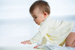Happy crawling baby. Royalty Free Stock Photography