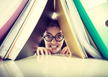 Happy crazy accountant with piles of binders. Royalty Free Stock Photography