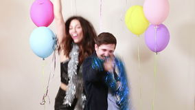 Happy crazy couple enjoying dancing in photo booth. Happy crazy couple enjoying dancing in party photo booth stock video