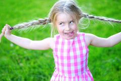 Happy crazy kid with long hair. Happy crazy little girl with long hair Royalty Free Stock Images