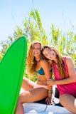 Happy crazy teen surfer girls smiling on car Royalty Free Stock Photos
