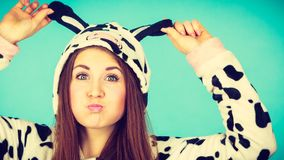 Happy crazy woman in cow costume Stock Photo