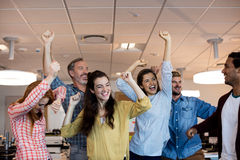 Happy creative business team celebrating success Stock Photos