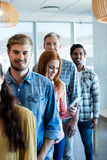 Happy creative business team standing in a line. In office Royalty Free Stock Photos