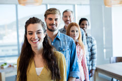 Happy creative business team standing in a line. In office Royalty Free Stock Photo