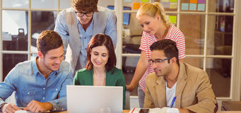 Happy creative business team using laptop in meeting Royalty Free Stock Image