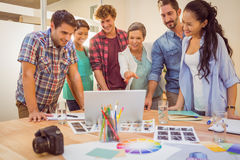 Happy creative business team using laptop in meeting Royalty Free Stock Photography