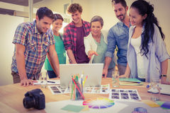 Happy creative business team using laptop in meeting Stock Photography