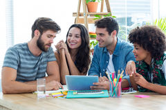 Happy creative business team using tablet in meeting Stock Photography