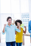 Happy creative businesswoman cheering  together Royalty Free Stock Image