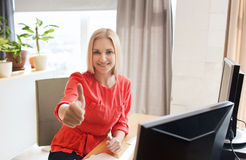 Happy creative female office worker with computers Royalty Free Stock Photo