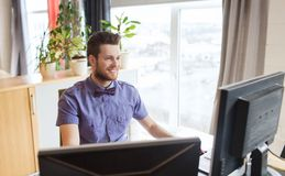 Happy creative male office worker with computer Stock Image