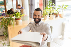 Happy creative male office worker with folfer Royalty Free Stock Image