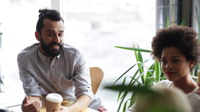 Happy creative team with coffee talking in office stock video