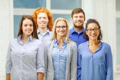 Happy creative team in office. Business, startup and office concept - happy business team in office Stock Photos