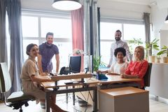 Happy creative team in office Stock Image